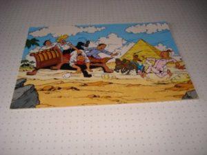 De Stulp De familie op vliegende bank in woestijn