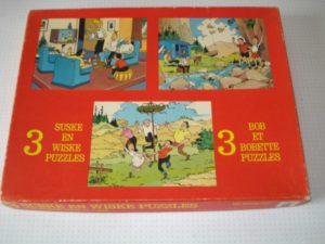 Puzzel 3 verschillende Familie danst rond de wisseltoe