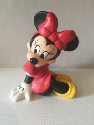 Minnie Mouse spaarpot handen op de grond