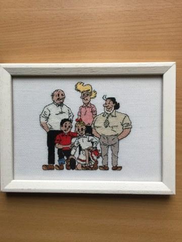 Fotolijstje met familie geborduurd